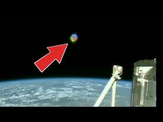 WOW! Huge UFO rises in earth orbit near ISS