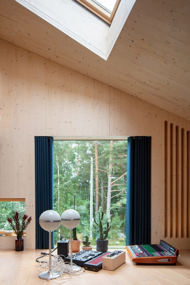 Ortraum Architects builds timber music studio beside house in Helsinki