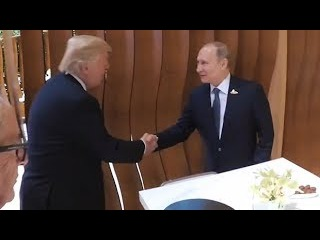 Donald Trump and Vladimir Putin shake hands for the first time