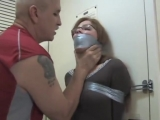 BoundHub - Girl in glasses captured, tape-tied and tape-gagged