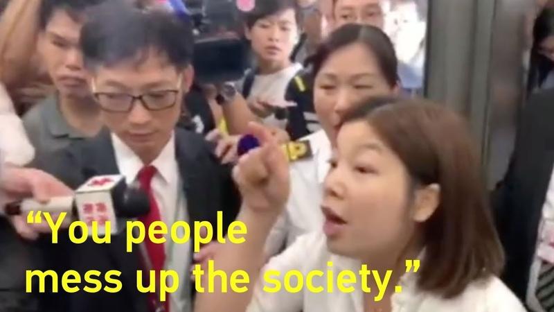 Woman grabs U S flag from HK rioters 'You people mess up society' 香港女子奪走暴徒手中的美國國旗:你們在擾亂社會!