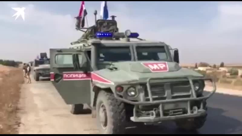 Russian military police patrolling along the M4 highway from Manbij to the Euphrates River