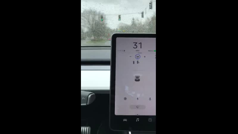 Tesla Autopilot stopping for red lights for the first time.