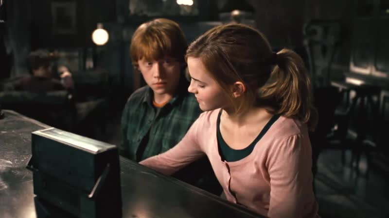 Ron and Hermione playing the piano